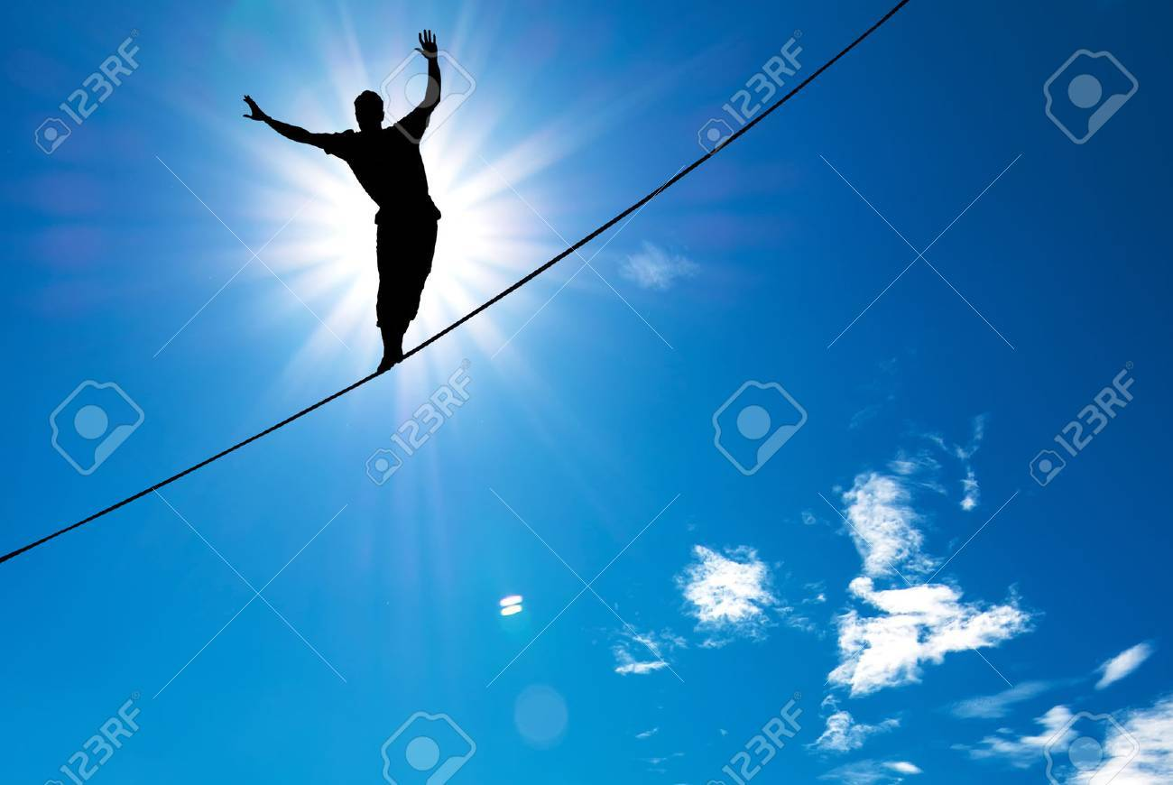 Man balancing on the rope concept of risk taking and challenge - 46627370