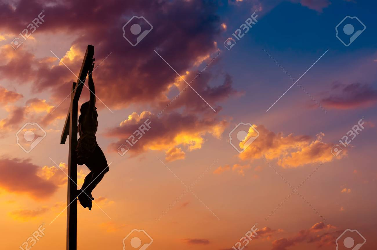 Silhouette of the holy cross on background of storm clouds stock - Crucifixion Jesus Christ Son Of God Over Dramatic Sky Background