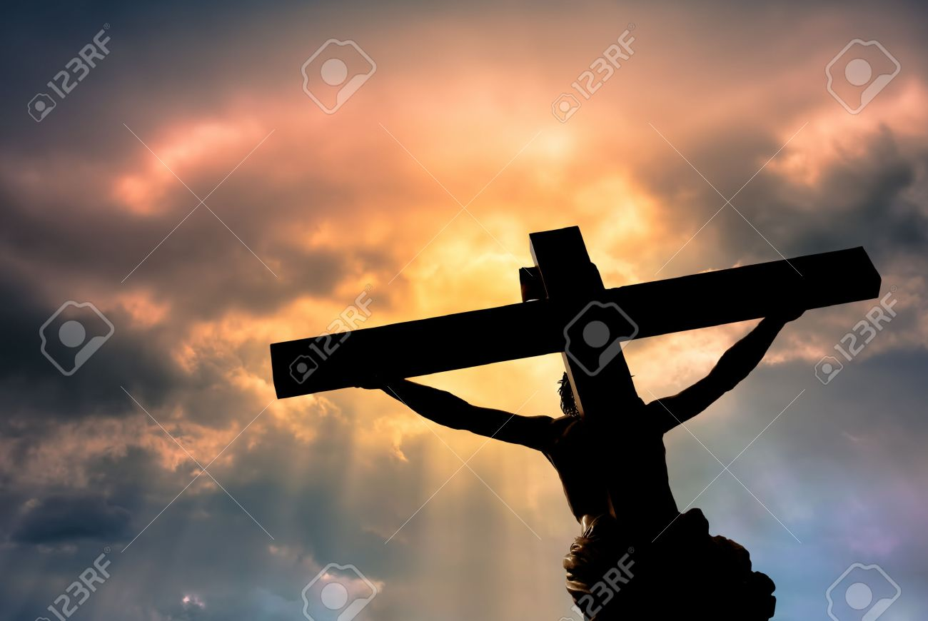 Silhouette of the holy cross on background of storm clouds stock - Crucifixion Jesus Christ Son Of God Over Dramatic Sky Background Religion And Spirituality Concept Stock