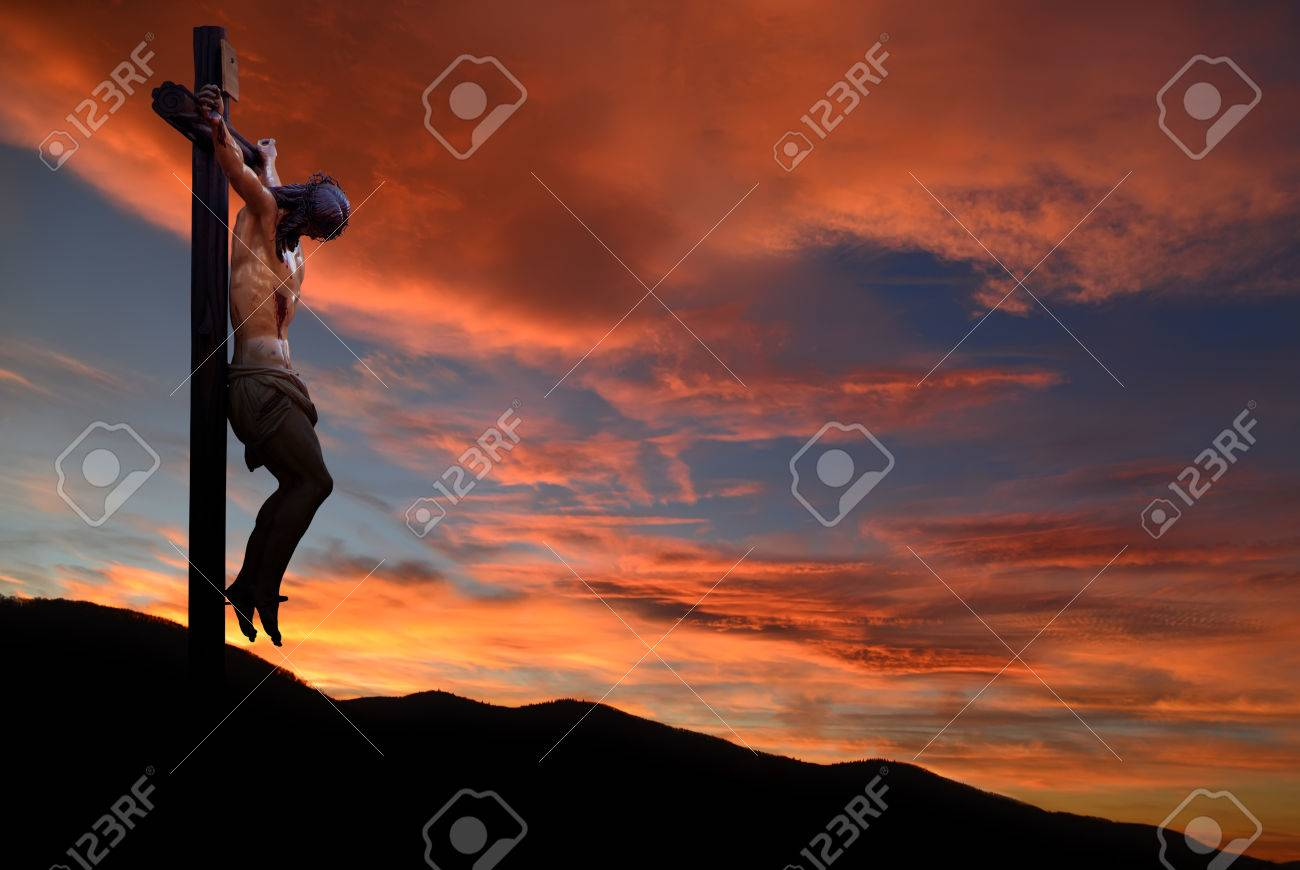 Jesus Christ on the cross over dramatic sky background - 54786542