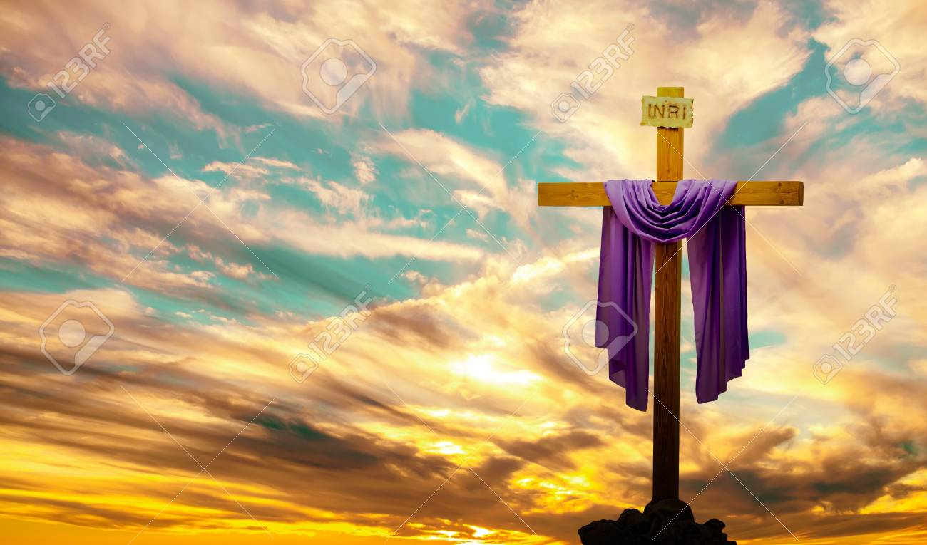 Silhouette of Christian cross at sunrise or sunset panoramic view - 61336773