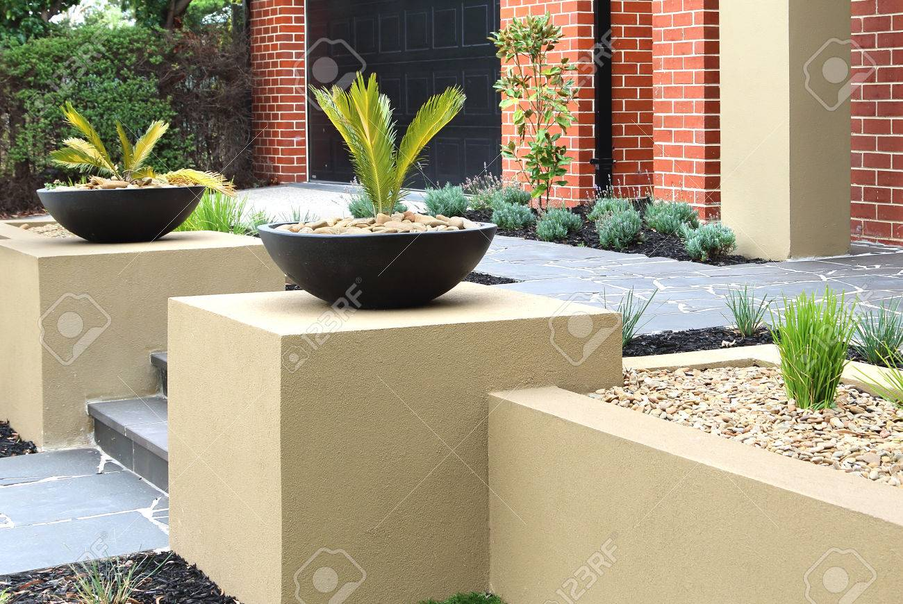 Combinations Of Plants Decking Paving And Rocks Stock Photo