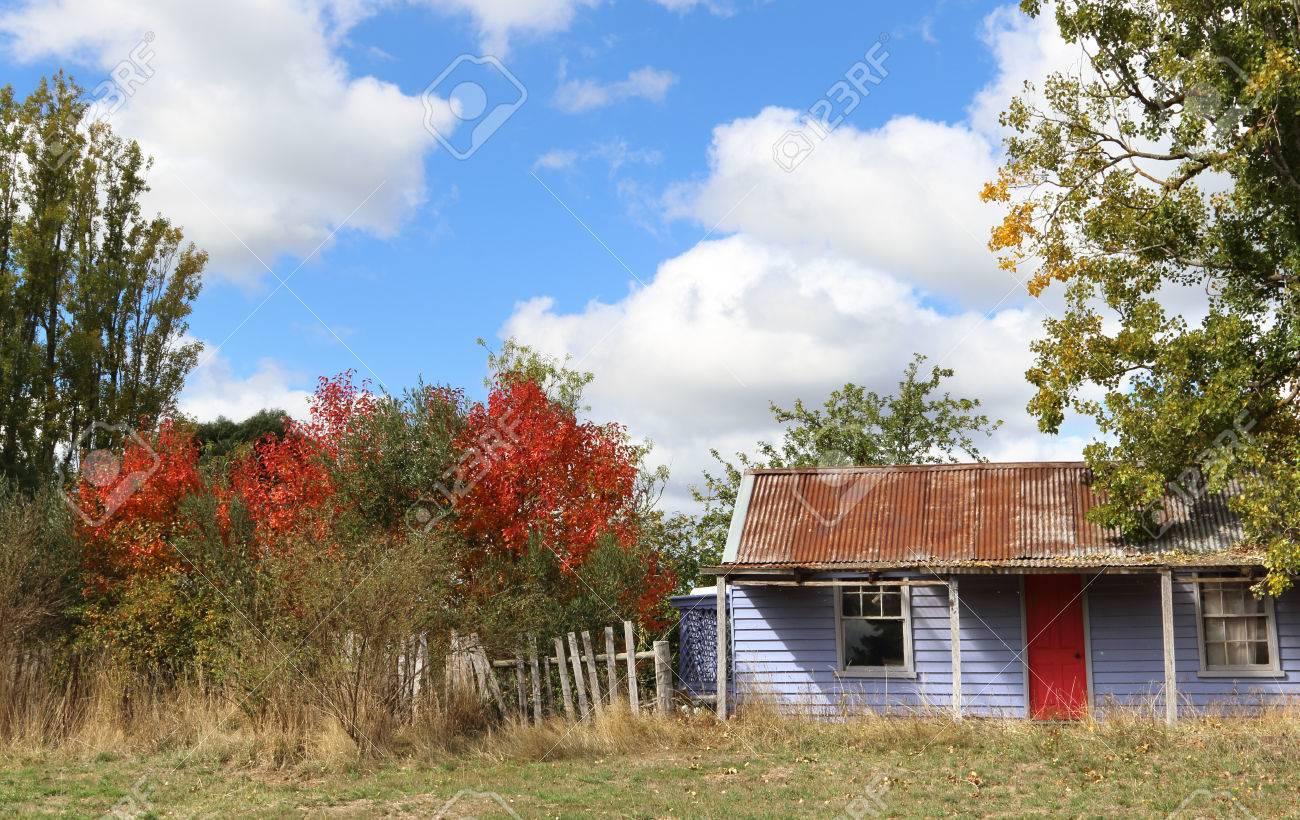 Old Australian abandoned farmhouse in sunny autumn day