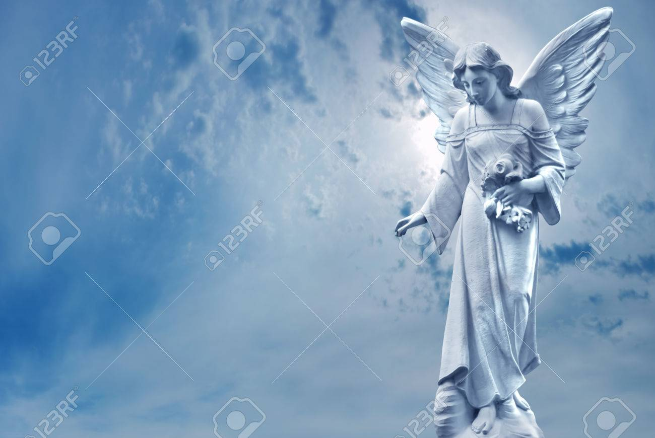 Angel sculpture on blue sky background concept of Religion - 81732422