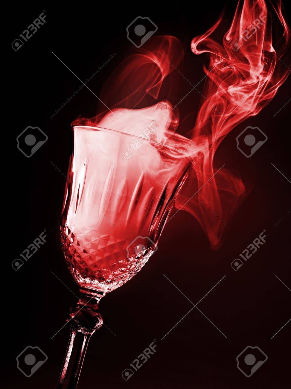 glass of magical smoke on black background Stock Photo - 12413805