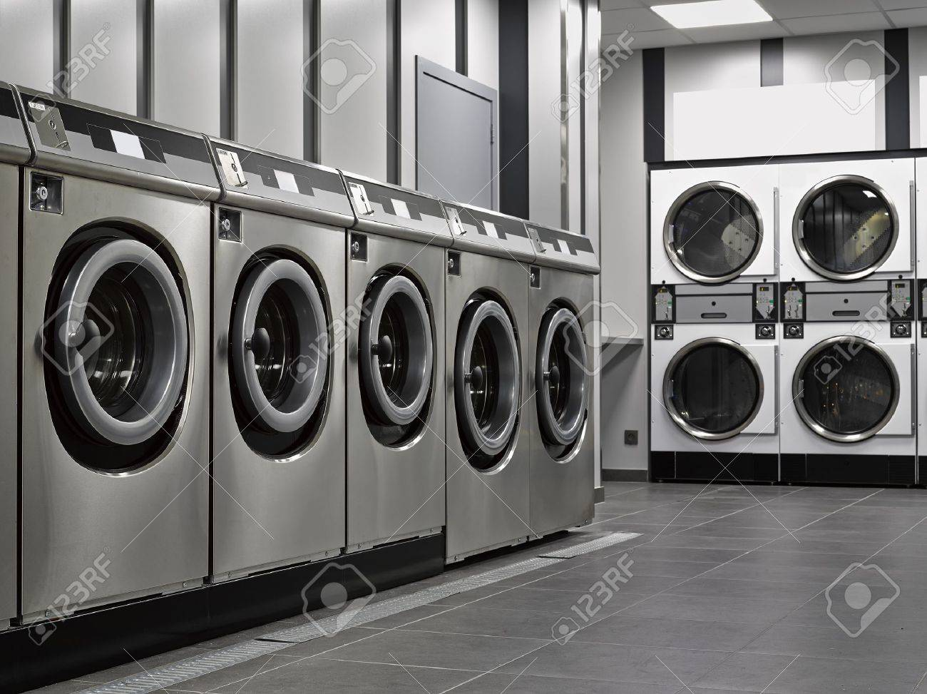 A row of industrial washing machines in a public laundromat Standard-Bild - 16813444