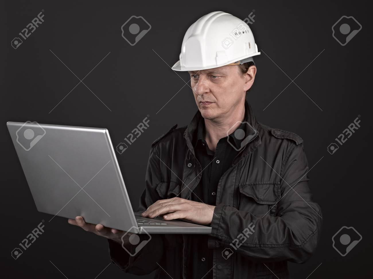 Portrait of a man architect on black background Stock Photo - 17385942