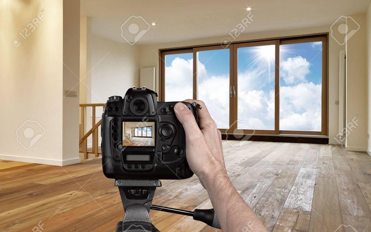 Man photographing empty living room with digital camera Standard-Bild - 22006359
