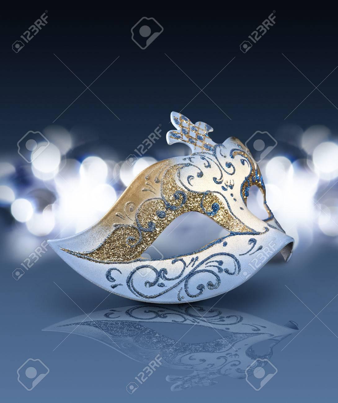 Female carnival mask with glittering background in blue mood Standard-Bild - 24697651