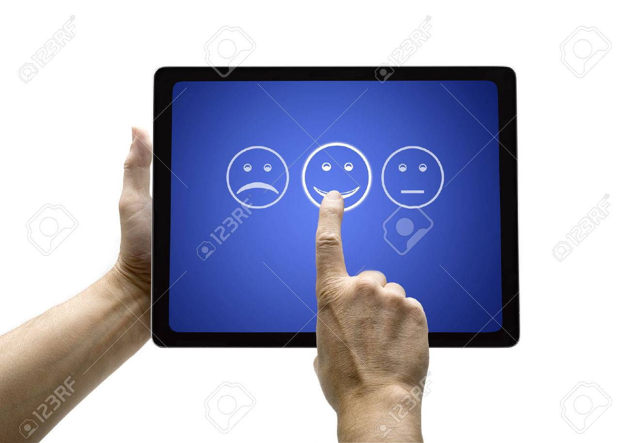 Hand touching screen with customer service evaluation form on a  tablet Standard-Bild - 30460286
