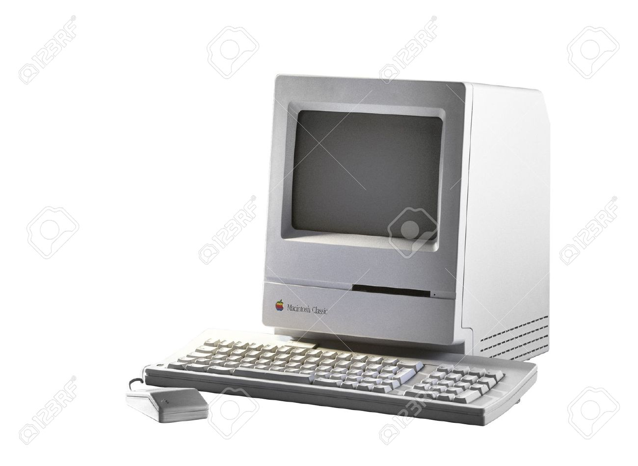 BRUSSEL,BELGIUM - CIRCA YEAR: Old Fashioned Computer and Mouse on Office Desk. Model Apple Macintosh Classic from 1990. Isolated on white with clipping path Standard-Bild - 41829638