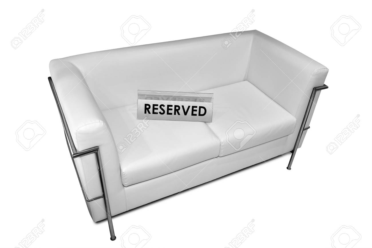 Reserved sign on white leather sofa isolated on white background..