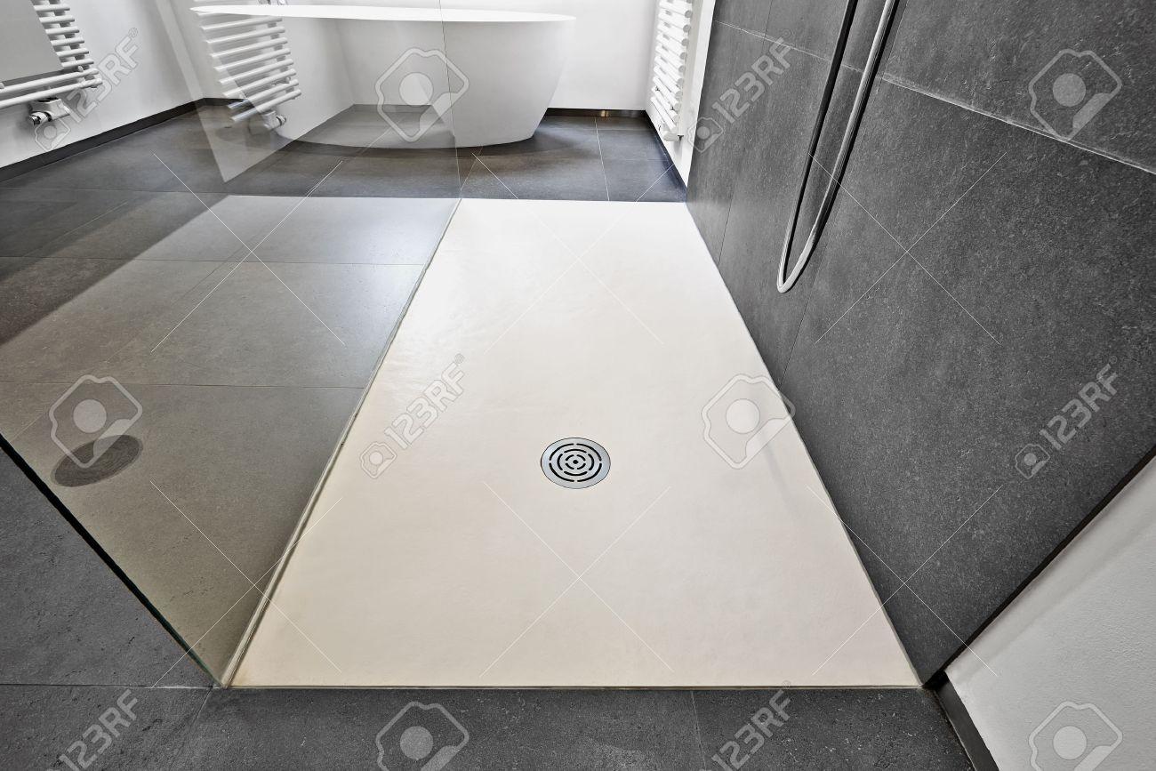 Corian floor and drain from modern shower in luxury bathroom Standard-Bild - 51686296