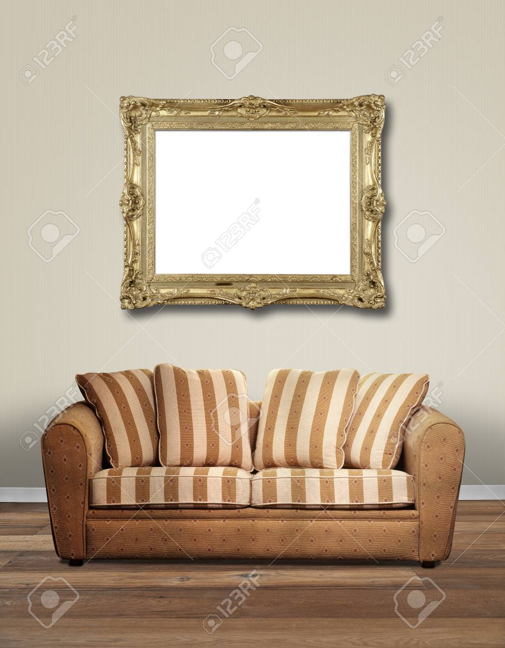 db151f644e2 Modern interior with sofa and old golden vintage frame. Souvenir in frame  at the wall