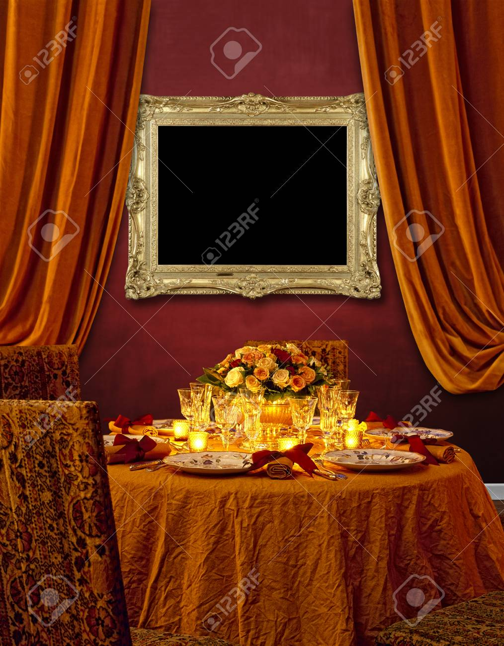 Luxurious Dining Table Against Red Textured Wall And Gold Frame Hanging Stock Photo