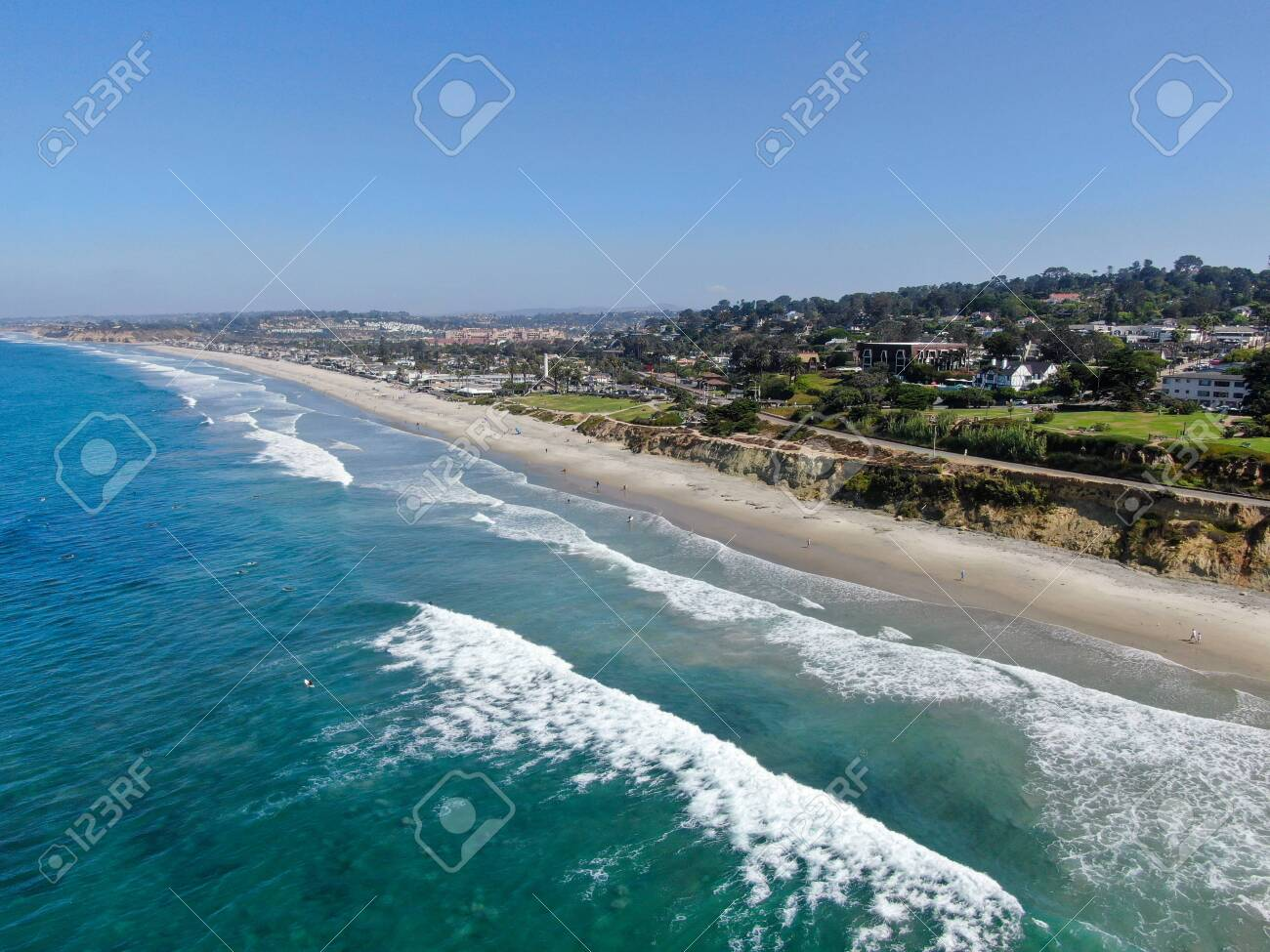 Aerial view of Del Mar coastline and beach, San Diego County, California, USA. Pacific ocean with long beach and small wave - 130995798
