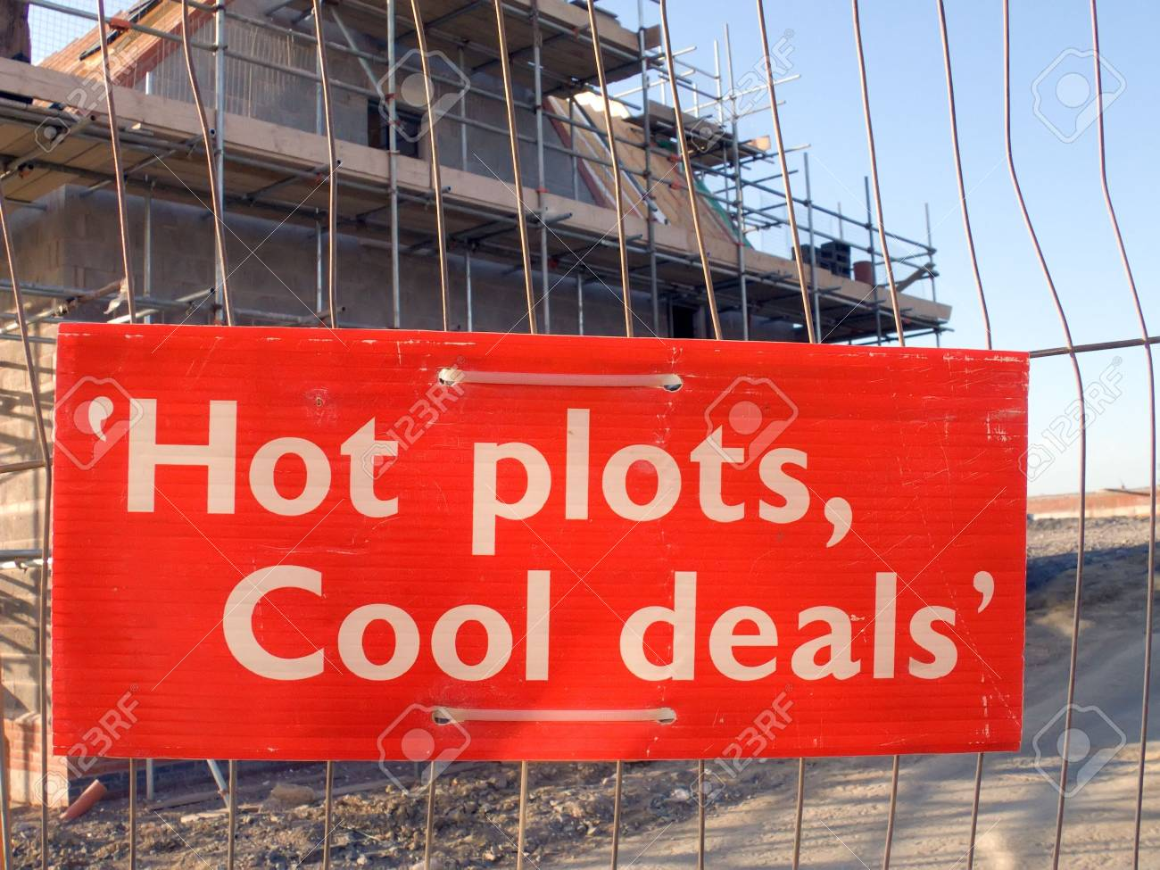 Sign on fence in front of new house construction Stock Photo - 1065048