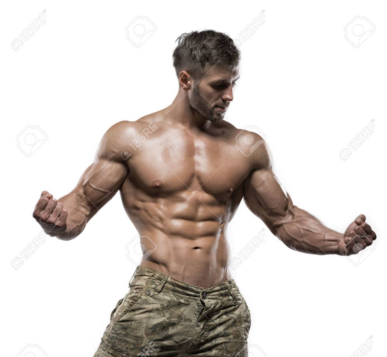 Young Handsome Muscular Man Bodybuilder Posing In The Studio Stock Photo Picture And Royalty Free Image Image 63466899 Many muscular men make the mistake of sizing up because they think they need the extra room for their extra bulk. young handsome muscular man bodybuilder posing in the studio