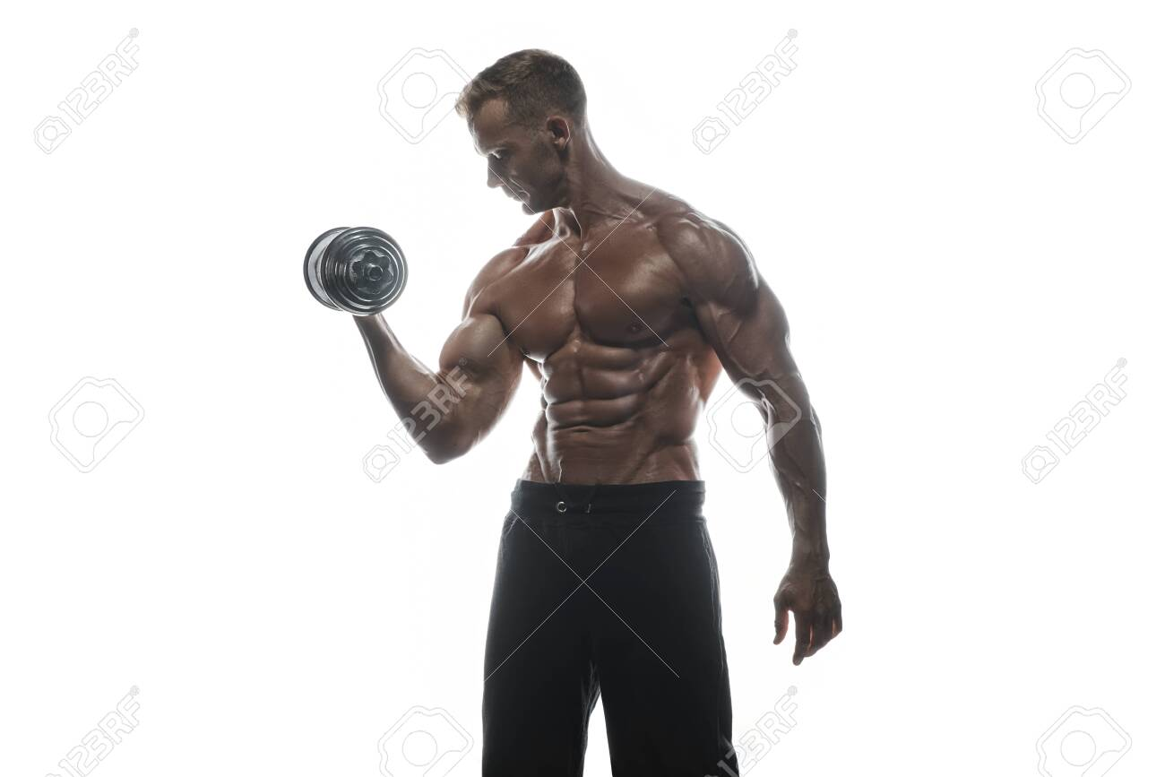 Fitness model Man posing in the studio. White background. Isolated. - 131454516