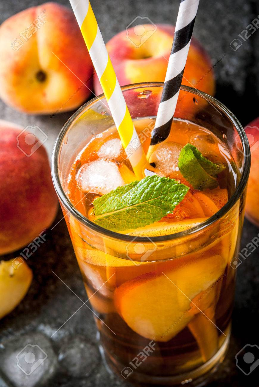 summer refreshment drinks iced tea with pieces of organic home made