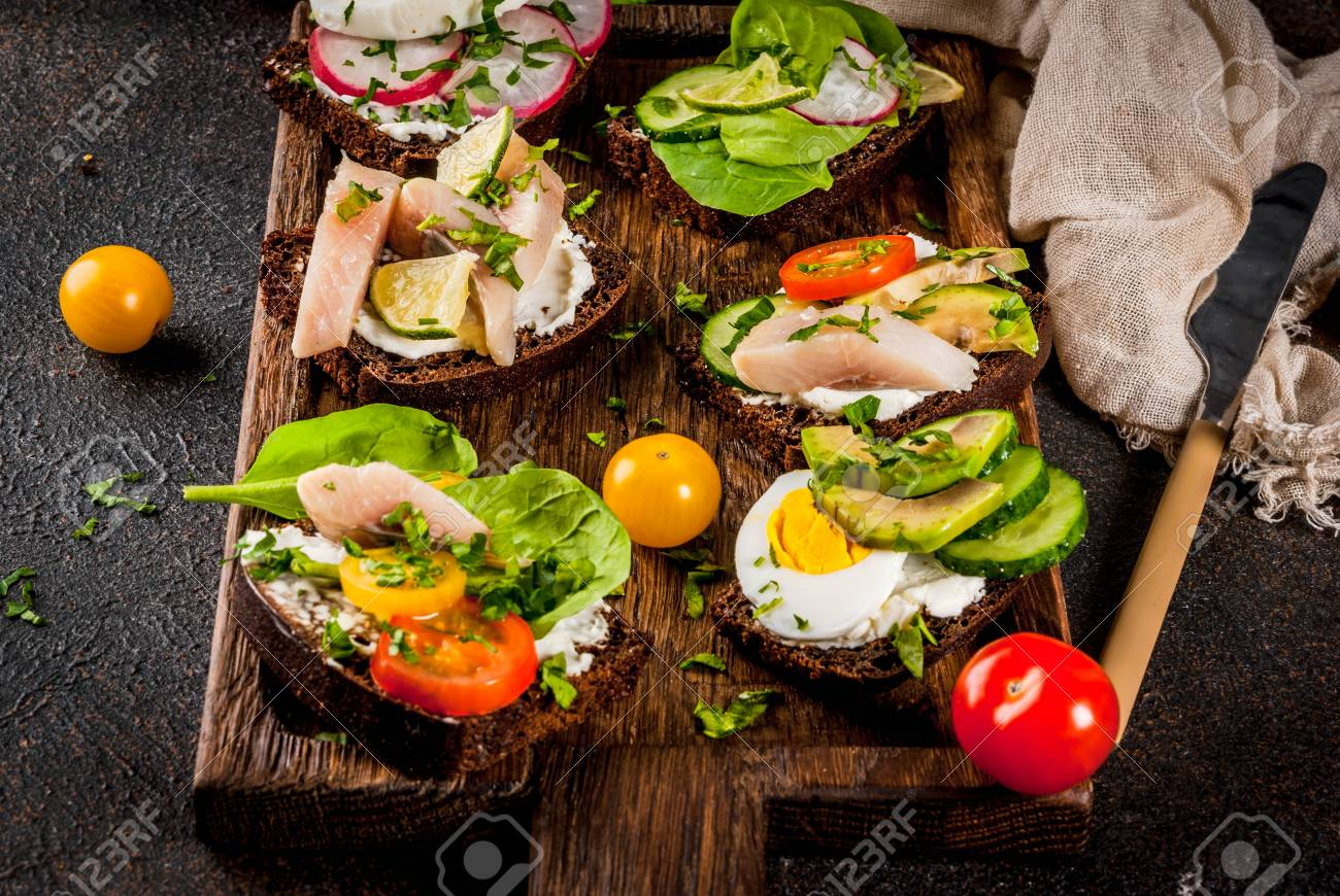 Set of various danish open sandwiches Smorrebrod with fish, egg