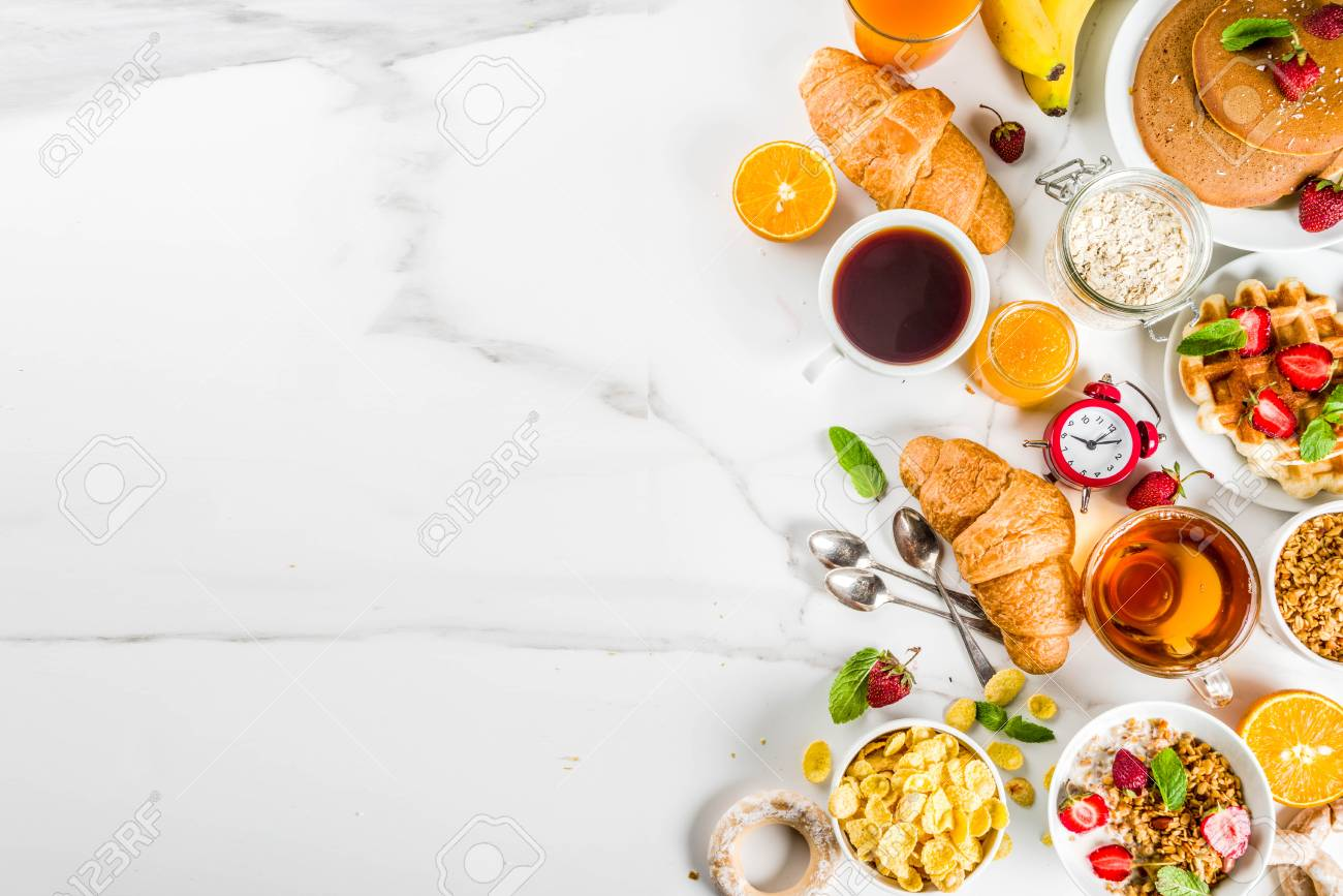 Healthy breakfast eating concept, various morning food - pancakes, waffles, croissant oatmeal sandwich and granola with yogurt, fruit, berries, coffee, tea, orange juice, white background - 102259282