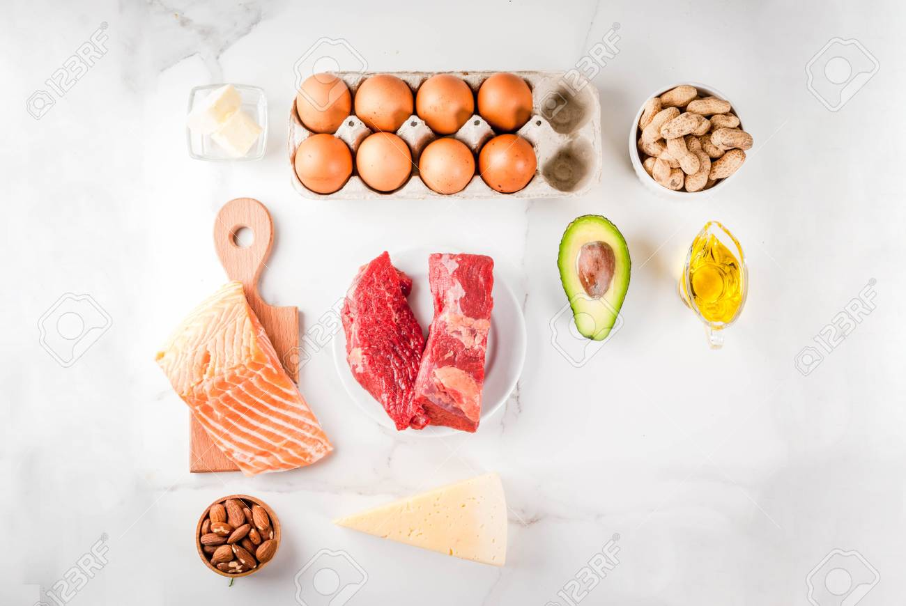 Ketogenic low carbs diet concept. Healthy balanced food with high content of healthy fats. Diet for the heart and blood vessels. Organic food ingredients, white marble background, copy space top view - 102741538