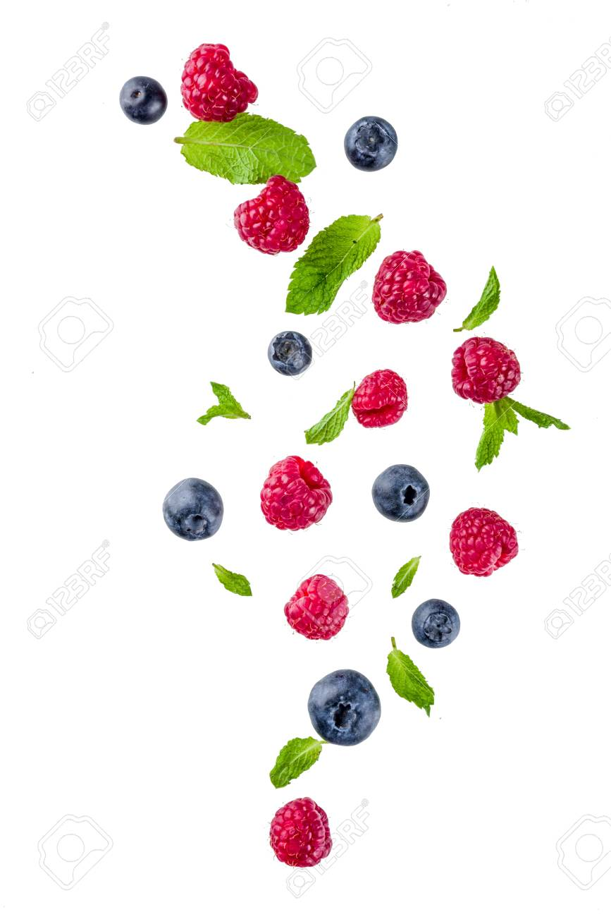 Creative layout, background, with fresh berries, simple pattern on white background. Raspberry, blueberry, mint leaves, slices of lemon. - 102929496