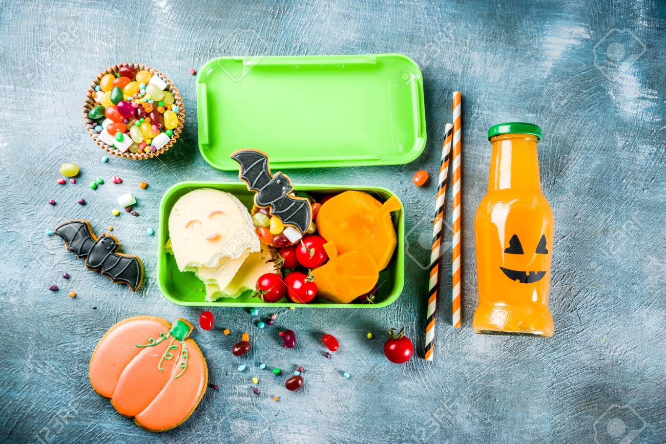 Halloween food, school lunch box with ghost sandwich, carved