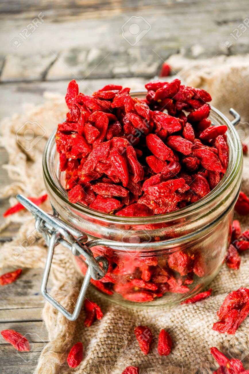 Dried goji berries in little jar, wooden background copy space - 126646702