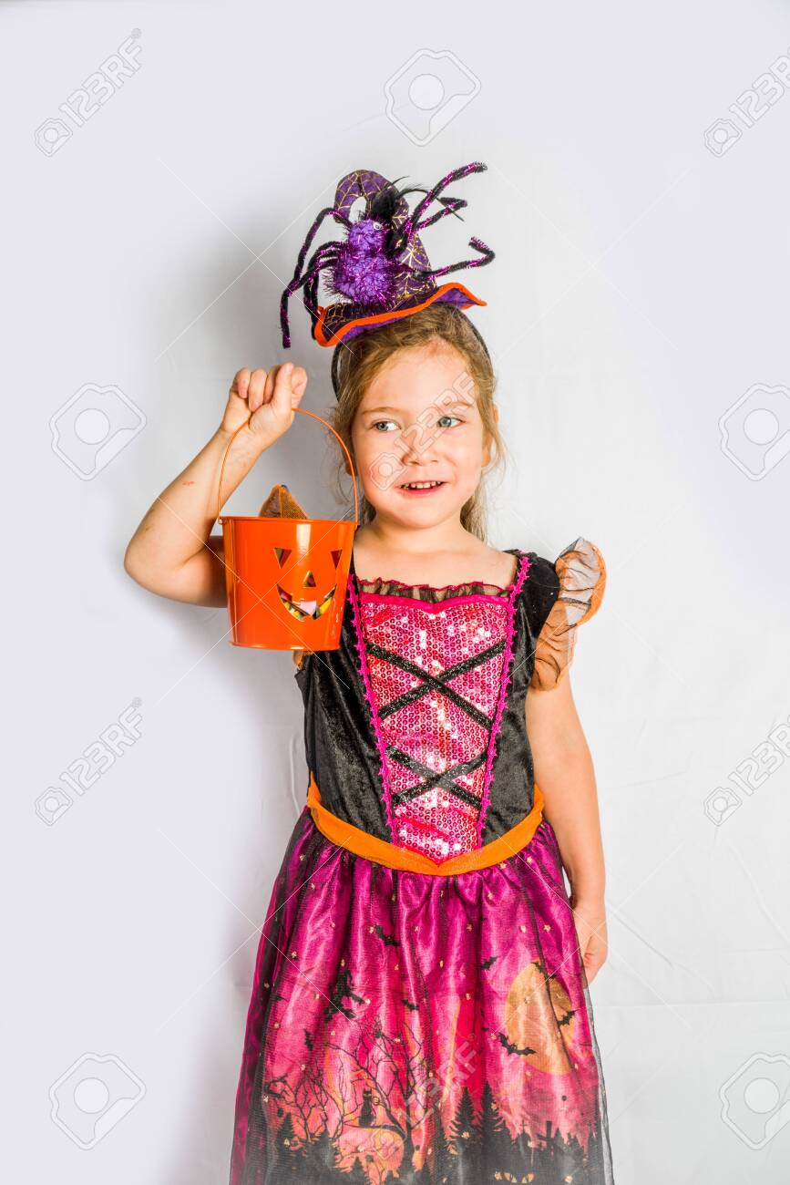 Little Cute Girl In Witch Costume For Halloween With Jack O Lantern Stock Photo Picture And Royalty Free Image Image 130928904