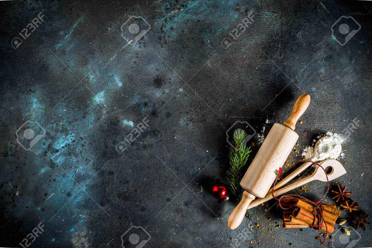 Christmas bakery background, with baking utensils, flour, spices and decorations, dark concrete table, copy space top view - 131425969