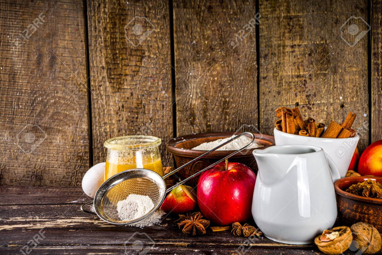 Autumn baking concept. Cooking baking background with ingredients, spices and utensils. All you need for baking traditional autumn apple pie, on rustic wooden background copy space - 148529682