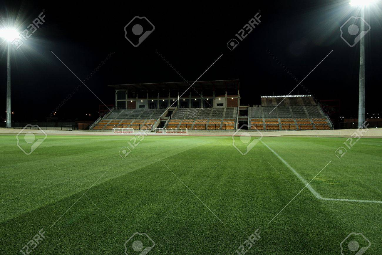 sports field being lit by floodlights Stock Photo - 7493869