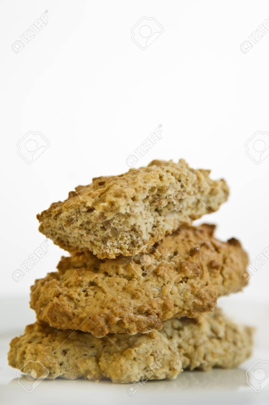 brown health cookies stacked on a white background Stock Photo - 20947757