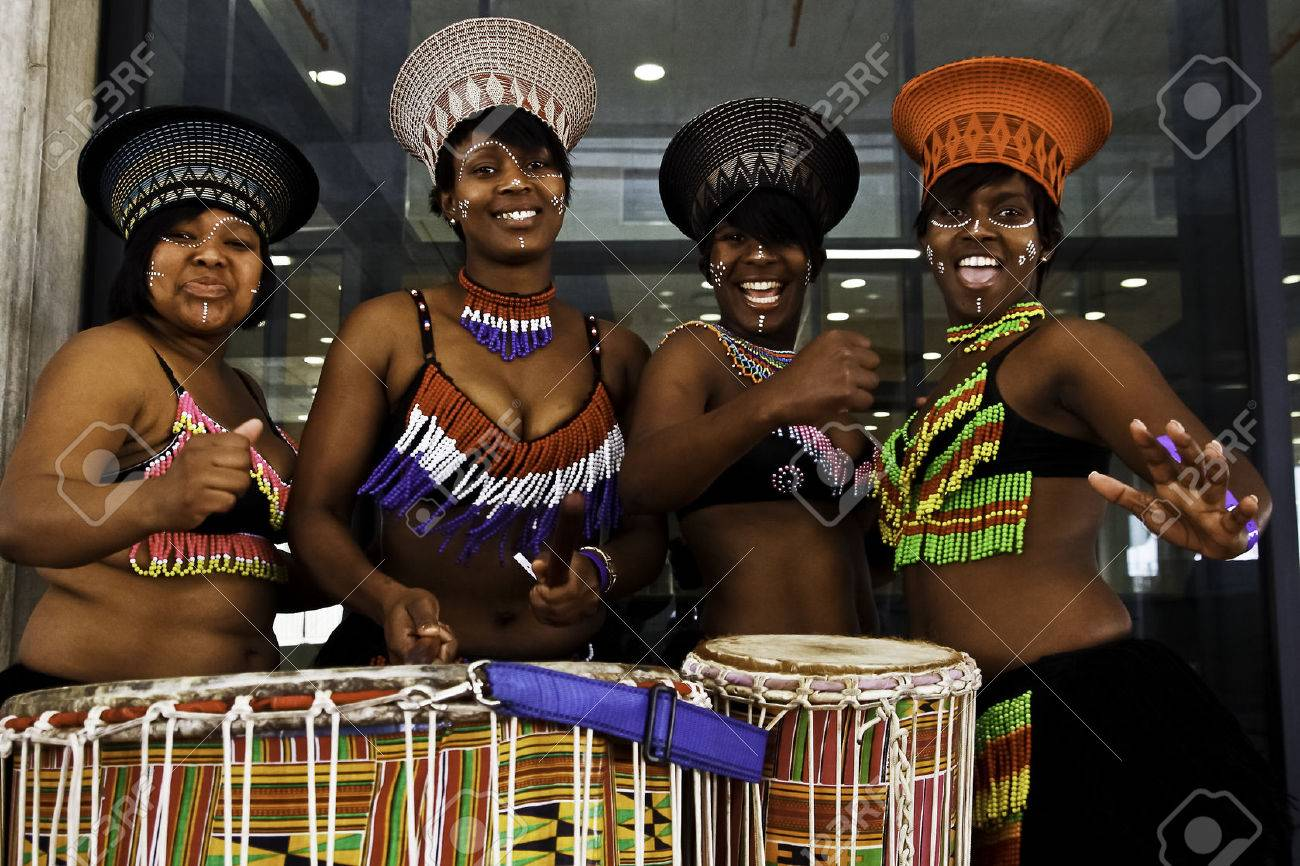 african dancers playing the drums and dancing during a Mayoral function at the Nelson Mandela Bay stadium 9 August 2009 Stock Photo - 29887524