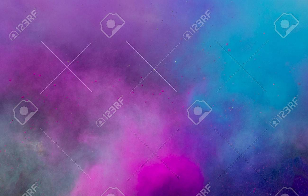 powder in different colours thrown into the air forming a huge cloud of smoke with little bits Stock Photo - 35016553