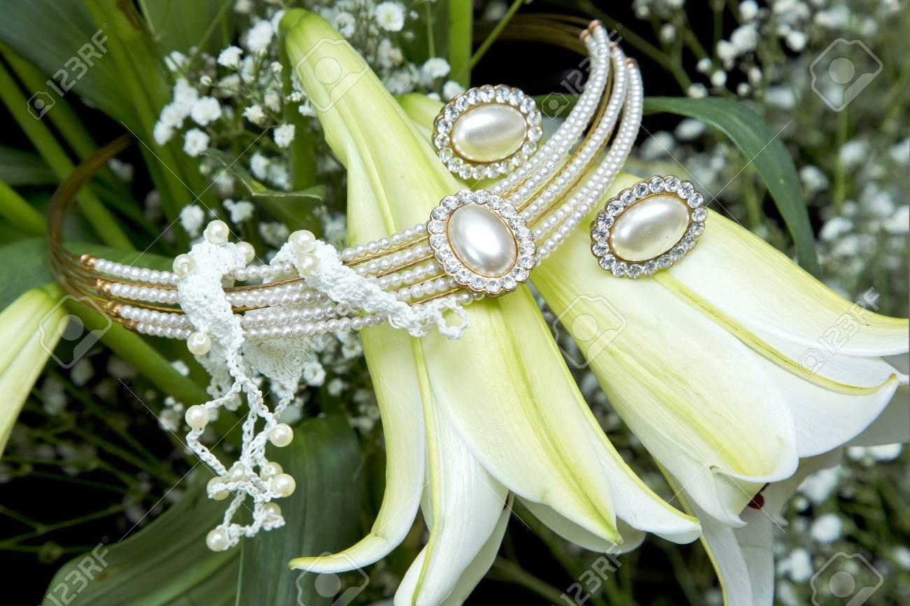 Beautiful Weeding Jewellery Placed On White And Yellow Tubular