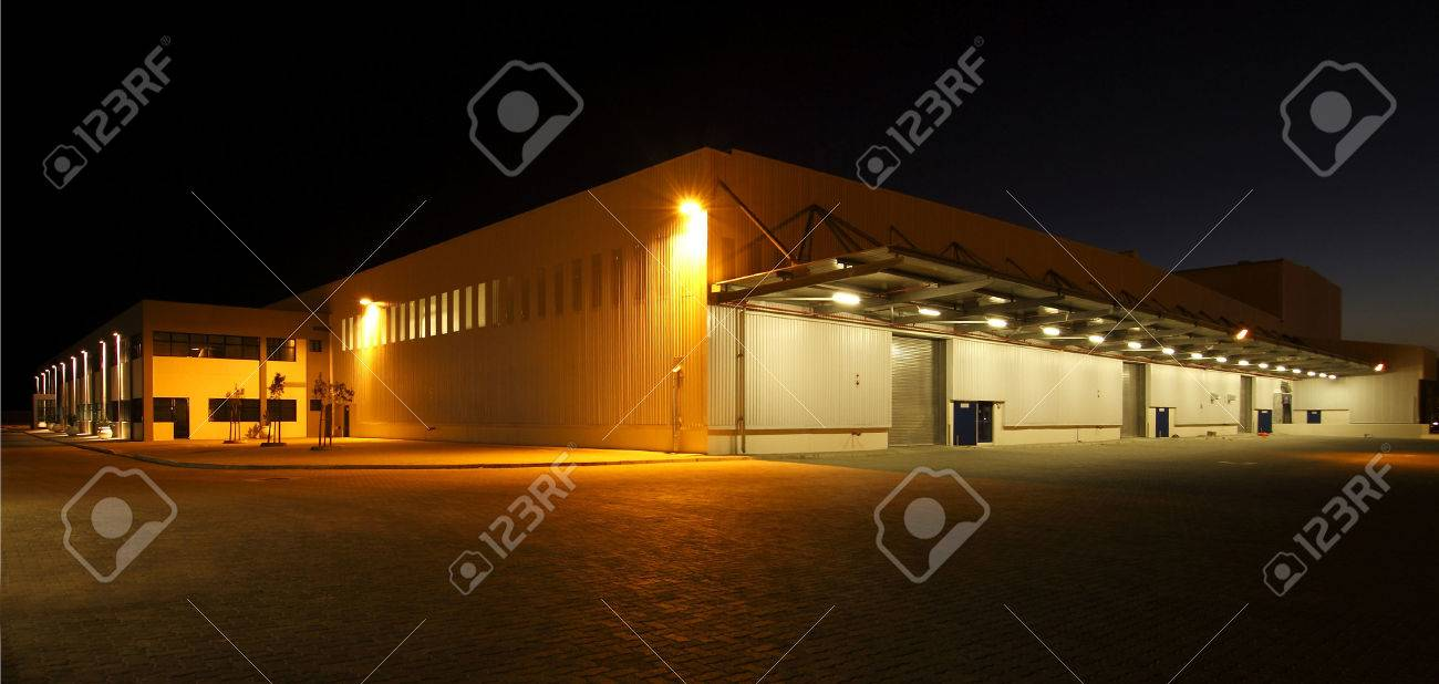 wide angle view of a modern warehouse at night in flood light light Stock Photo - 48633241