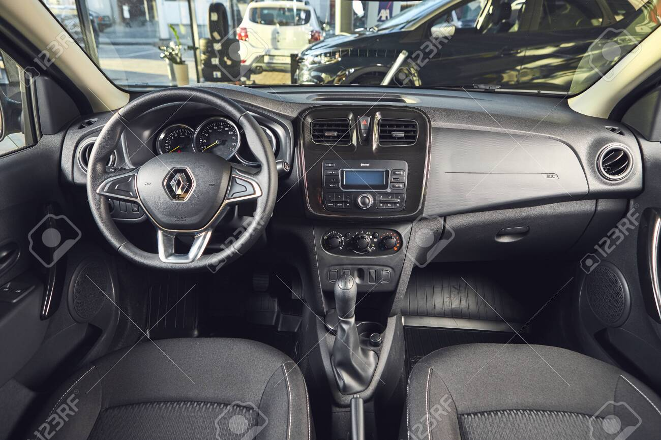 Vinnitsa, Ukraine - April 02, 2019. Renault Logan MCV - new model car presentation in showroom - steering wheel and dashboard view - 138212458
