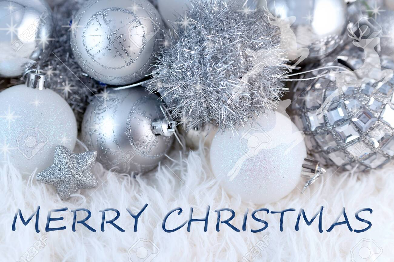 Merry Christmas Greeting Text On Shiny Silver Christmas Tree Stock Photo Picture And Royalty Free Image Image 152809561