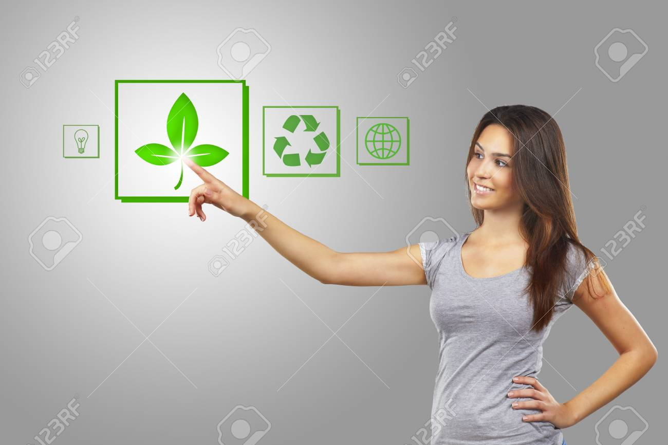 Young woman pointing at eco icons Stock Photo - 16693222