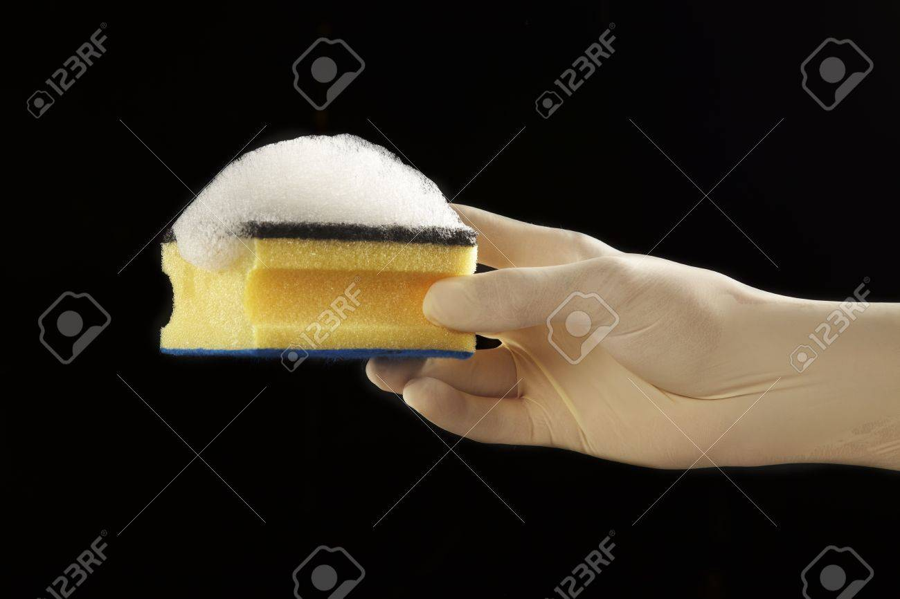 still life of a scourer and a latex glove Stock Photo - 16701753
