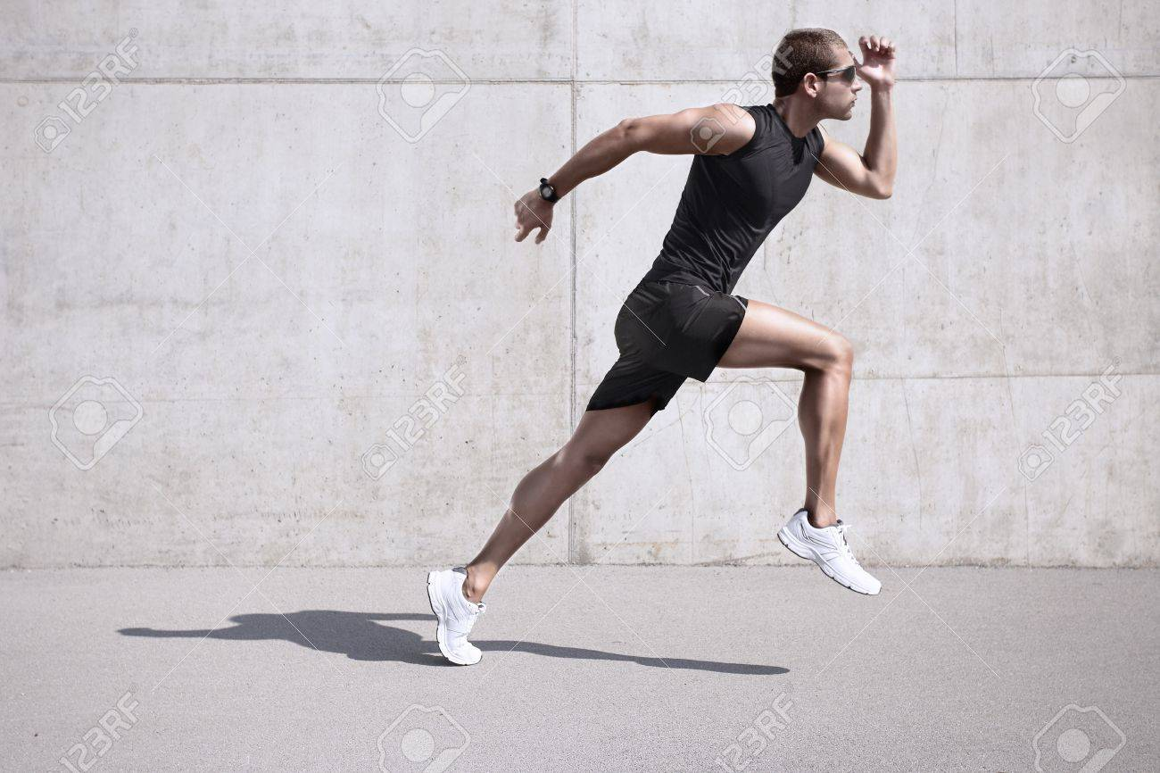 young man jogging front cement wall Stock Photo - 16801018