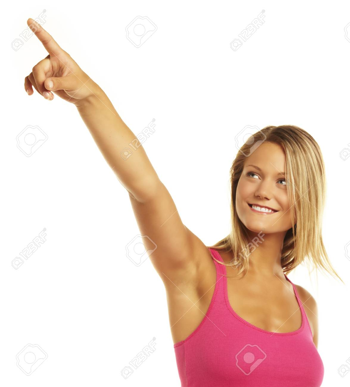 Portrait of a happy young woman pointing Stock Photo - 16903792