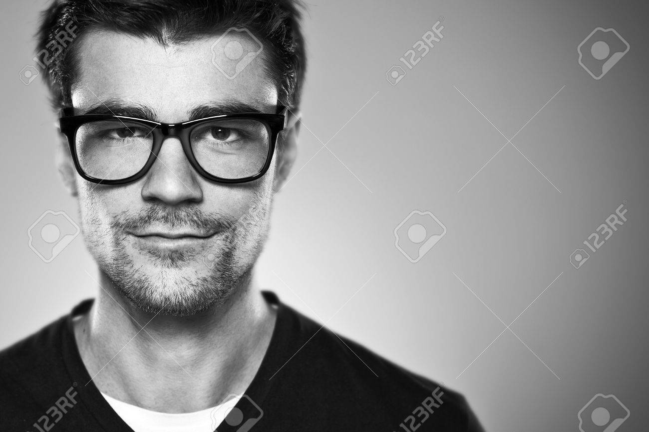 Attractive young man in studio looking at camera Stock Photo - 19116751