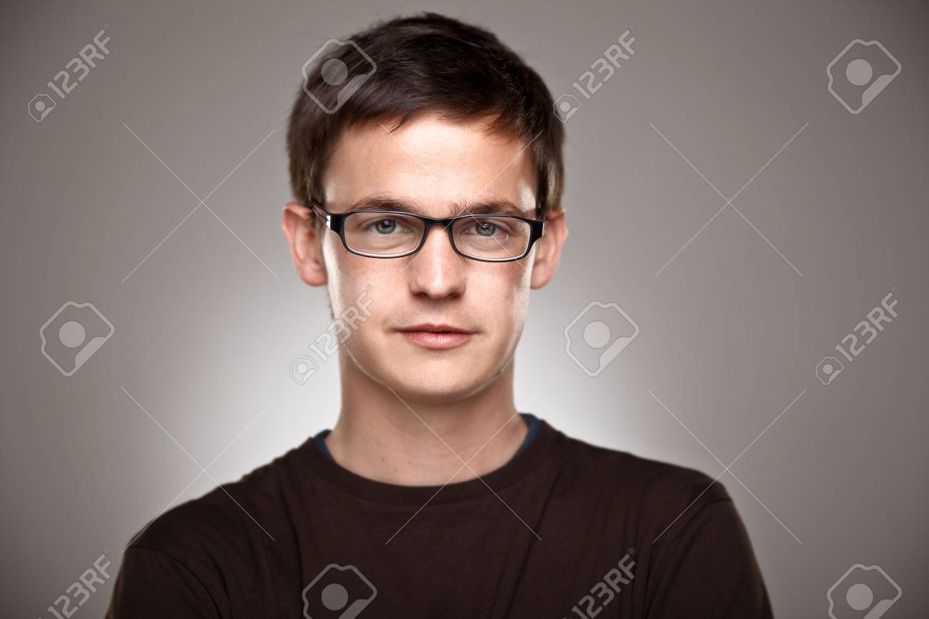 Attractive young man in studio looking at camera Stock Photo - 19382165