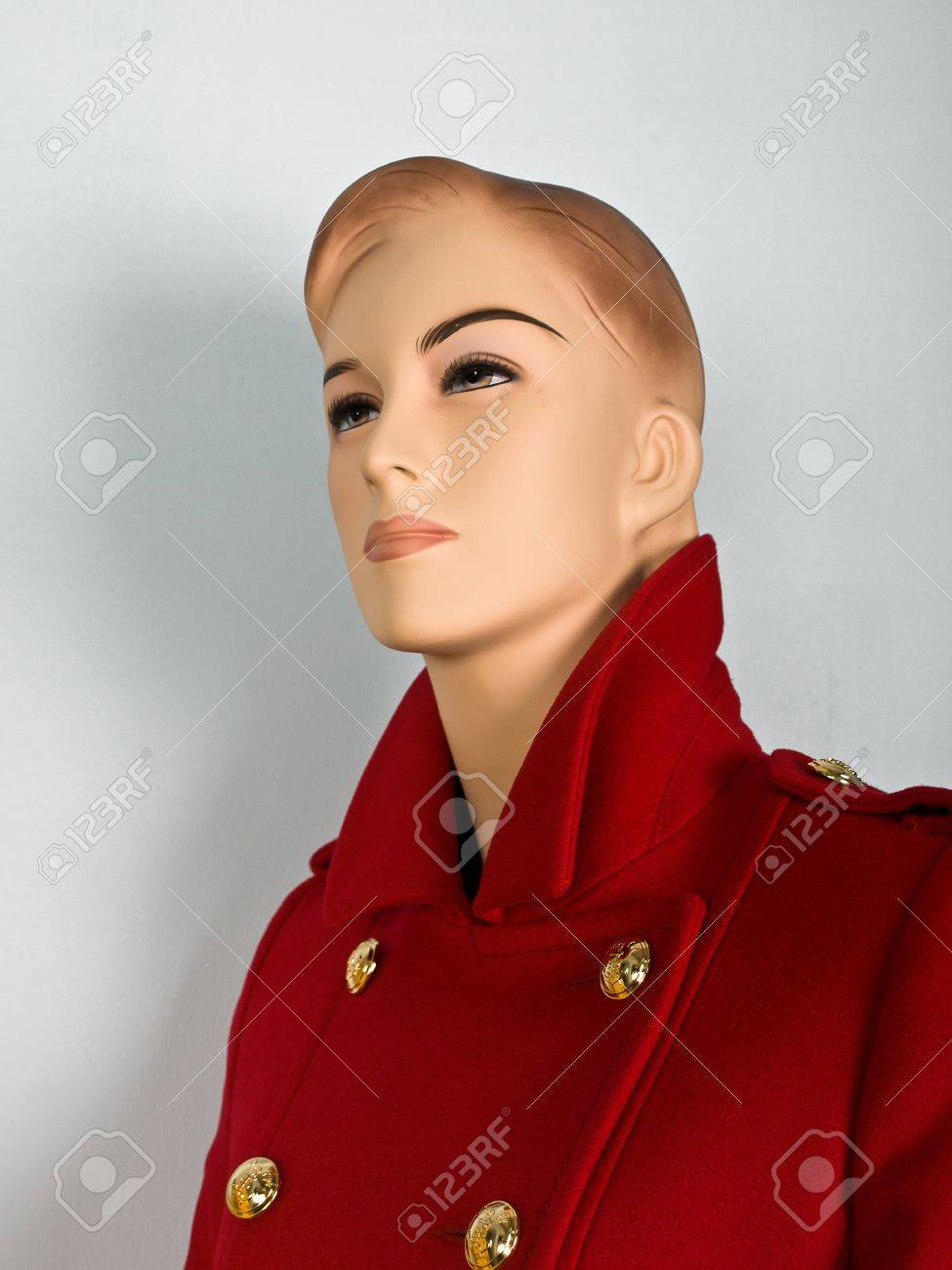 Red coat on mannequin in shop Stock Photo - 8296314