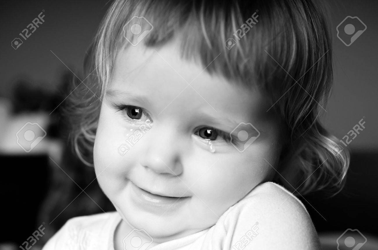 Crying little girl with focus on her tears - 11567377