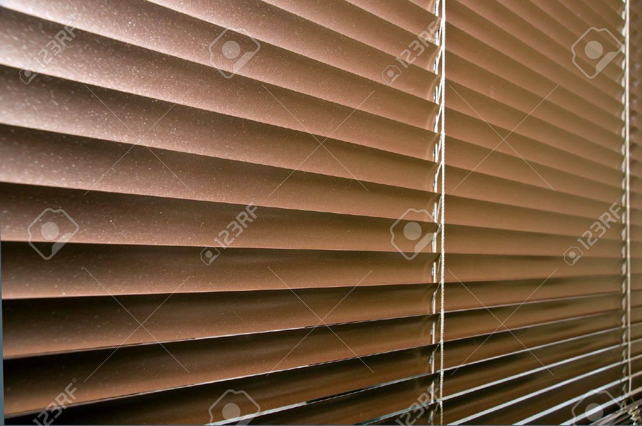 Aluminium colorized blinds on plastik window. Perspective view. Stock Photo - 12409766